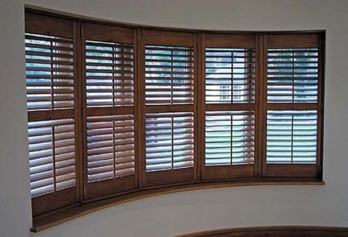 Benefits of interior solid wood shutter blinds by all for Should plantation shutters match trim